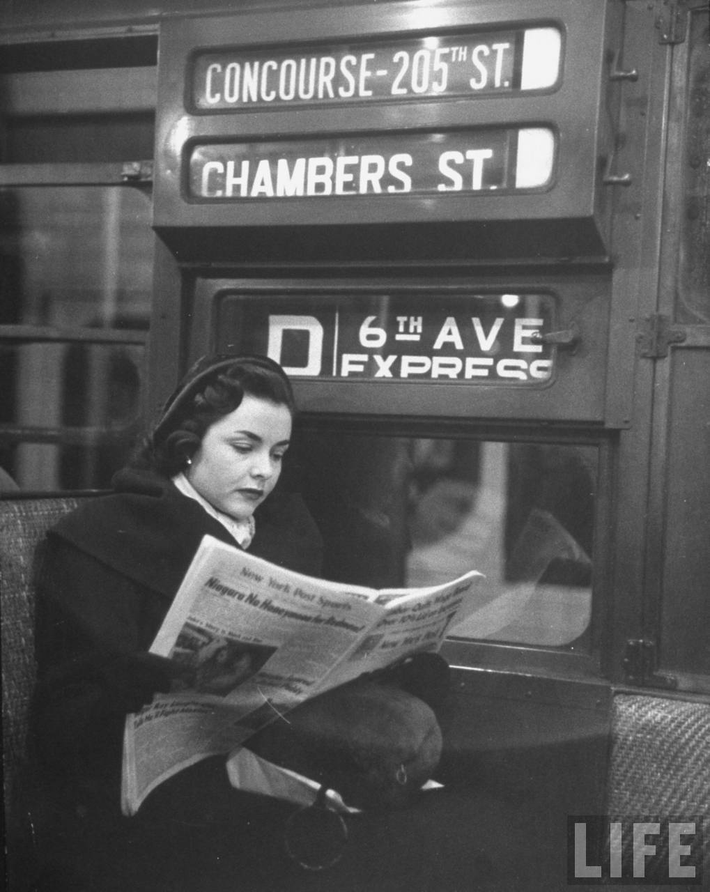Woman Reading on the Subway